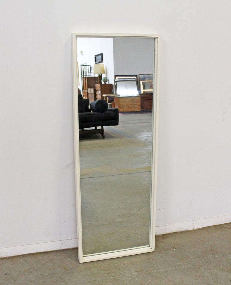 Offered is a vintage Mid-Century Modern mirror by Paul McCobb for Planner Group. This piece came with a matching and signed bedroom set. Has a hanger on the back. It was painted by the previous owner, but still in good condition with a few scratches
