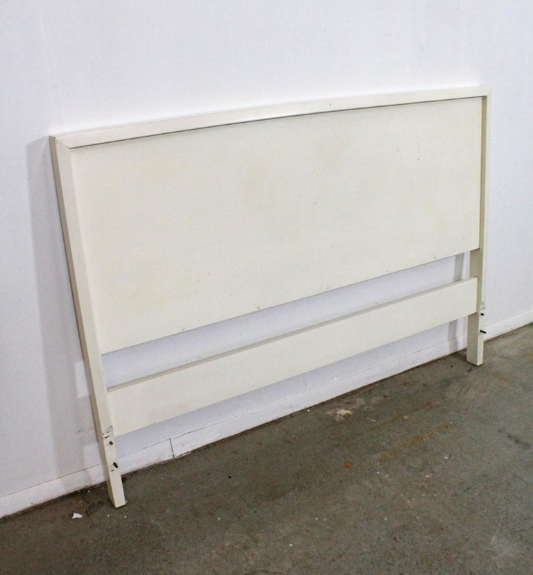 Offered is a vintage full-size headboard, designed by Paul McCobb for Planner Group. This piece is in good condition for its age, has been repainted by its previous owner, but is structurally sound. Has some surface wear, stains, and scratches (see