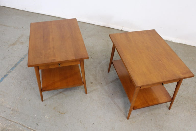 Mid-Century Modern Paul Mccobb nightstands/end tables Offered is a pair of mid-century nightstands with sleek lines designed by American designer Paul Mccobb. Made from yellow birch, these stands feature beautifully sculpted legs and two drawers