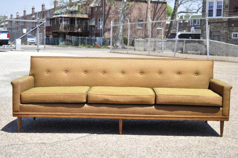Mid-Century Modern Paul McCobb style wood frame sofa couch by J.B. Van Sciver. Item features solid wood trimmed frame, flared arms, solid wood frame, original label, tapered legs, clean modernist lines, sleek sculptural form, circa mid-20th century.