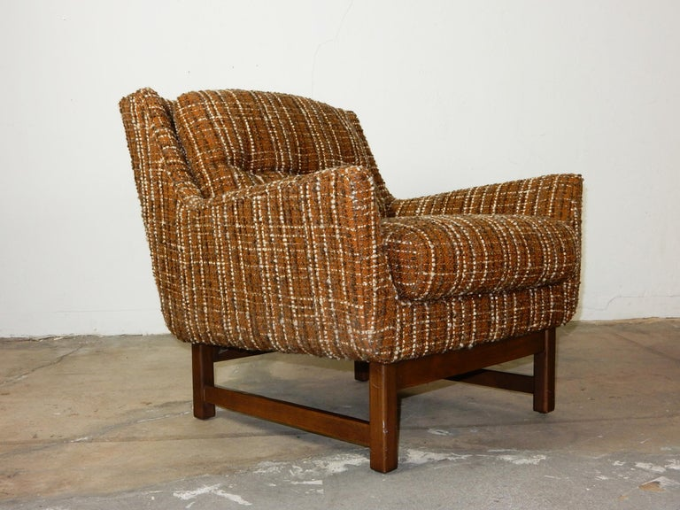 Sexy petite pair of original 1960s lounge chairs in their original nubby wool weave upholstery. In the style of Jens Risom, they are exceptionally comfortable and plush. Upholstery and foam are soft. Frames are solid with original dark walnut