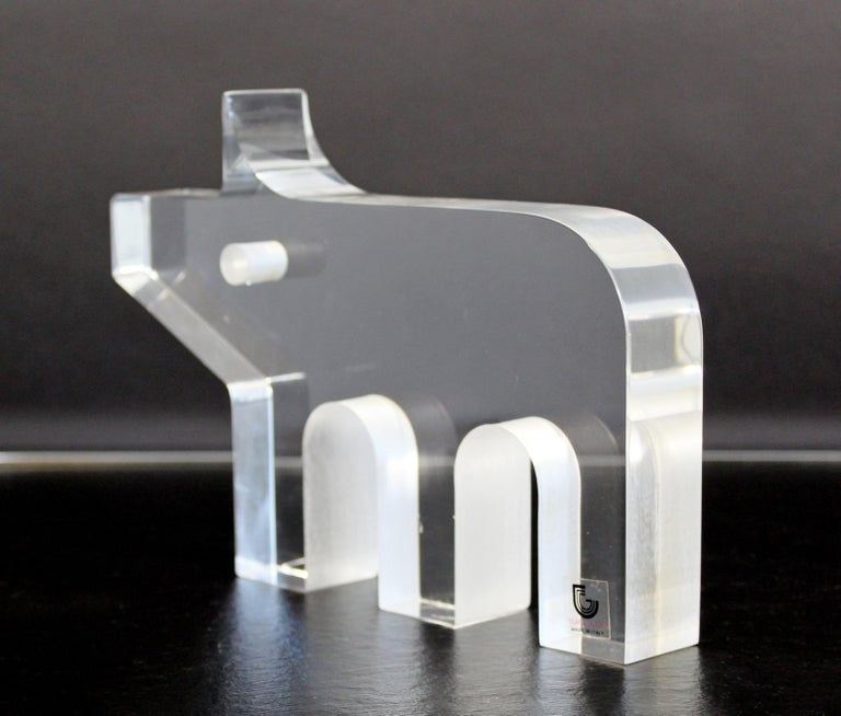 For your consideration is a whimsical, pig table sculpture, made of clear Lucite, by Silvio Russo for Guzzini, circa 1970s. In excellent vintage condition. The dimensions are 8