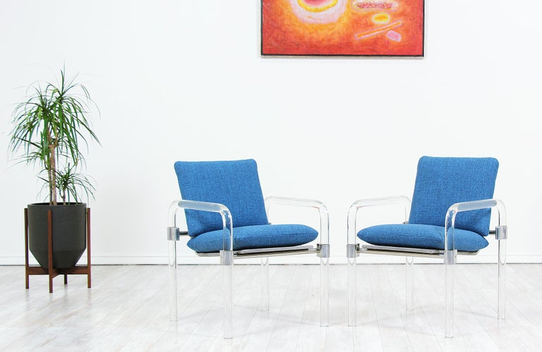 Pair of iconic armchairs designed by Jeff Messerschmidt manufactured by Jeff Messerschmidt Studio in the United States, circa 1980s. This unique design belongs to the Pipeline Series II and features a Lucite frame with steel hardware. The clean,