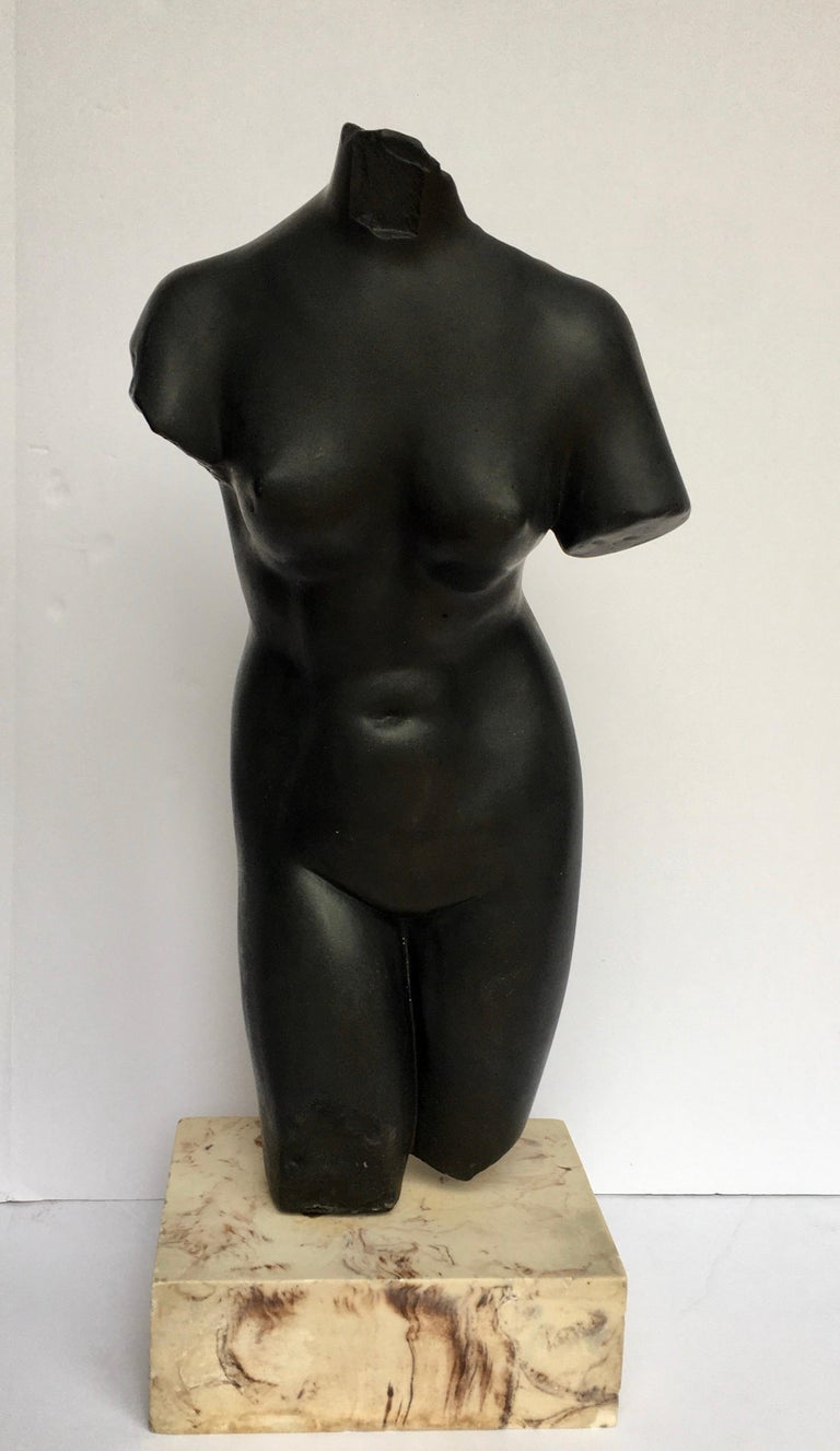 Large Mid-Century Modern female torso sculpture mounted on a solid marble plinth base. Bust is molded from a heavy weight solid black plaster.