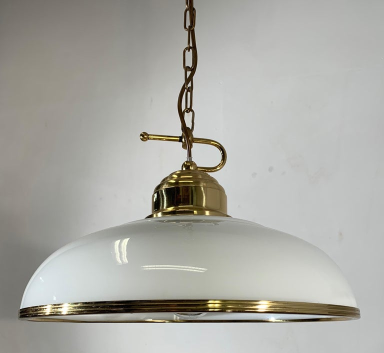 Good size, beautifully designed and excellent quality light fixture.  If you are looking for a midcentury light fixture then this beautiful brass pendant with its clear white opaline shade could be perfect for you. It comes with a solid brass chain