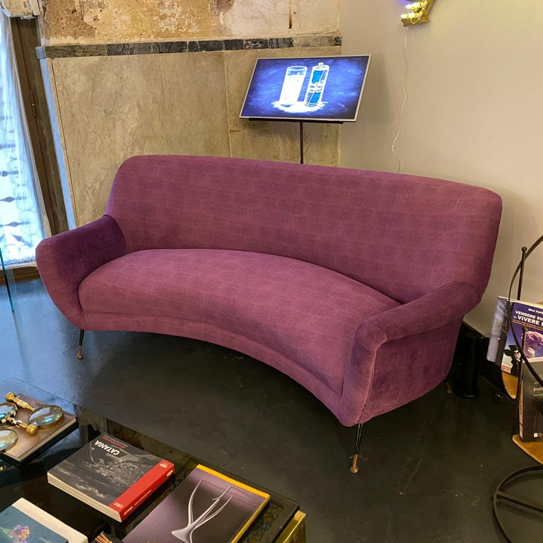 A Mid-Century Modern recently upholstered sofa in the manner of Gigi Radice made in Italy in the 1960s. Brass it's in original patina, purple velvet it's in perfect conditions.