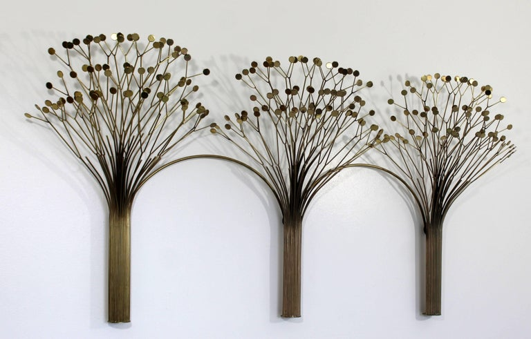 For your consideration is a spectacular, brass wall sculpture of three trees, signed Curtis Jere and dated 1971. In excellent condition. The dimensions are 64