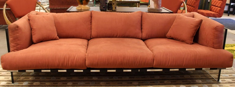 For your consideration is a magnificent, three-seat sofa, with smoked Lucite sides and a chrome base with leather straps, by Milo Baughman. In very good condition, with some marks on the upholstery. The dimensions are 90