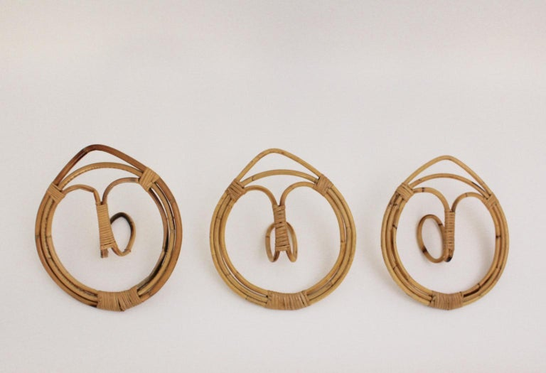 This set of 3 vintage rattan coat hooks was designed by Franco Albini & Franca Helg, Italy 1961 and manufactured by Bonacina. If you want to mix some Riviera style into your interior these pieces are well qualified.  Measures: Diameter 35 cm.