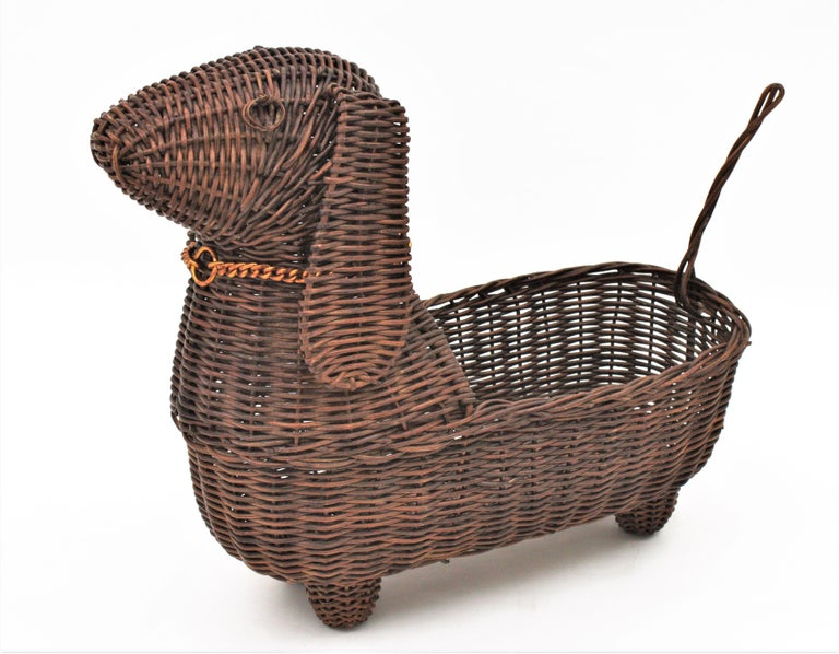 Lovely woven rattan decorative basket in the shape of a dog, France, 1960s. This unusual handcrafted basket has a very realistic dog design accented by a gilt metal chain dog collar. Add a custom made cuddling cushion for your domestic pets. This