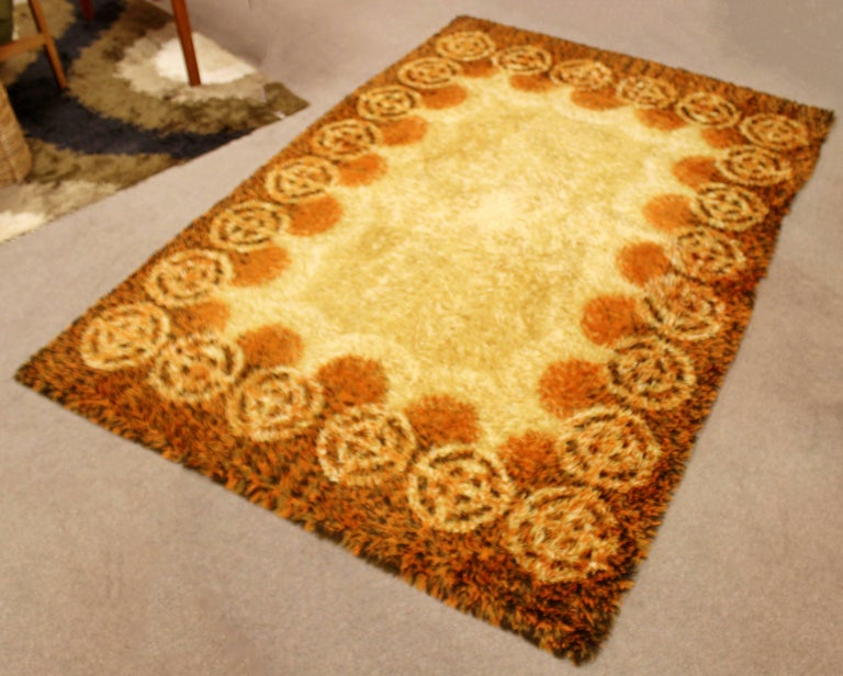 For your consideration is a stunning, vibrant orange, rectangular rya rug or carpet, circa 1960s. In good condition. The dimensions are 100