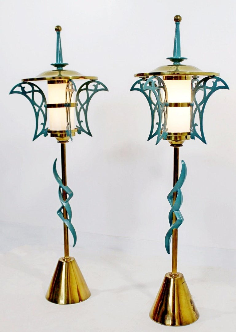 For your consideration is a magnificent pair of solid brass table lamps, cold painted, with wood finials and glass inserts, from Rembrandt, circa 1957. From the Doral Country Club. In excellent vintage condition. See pictures for condition. The