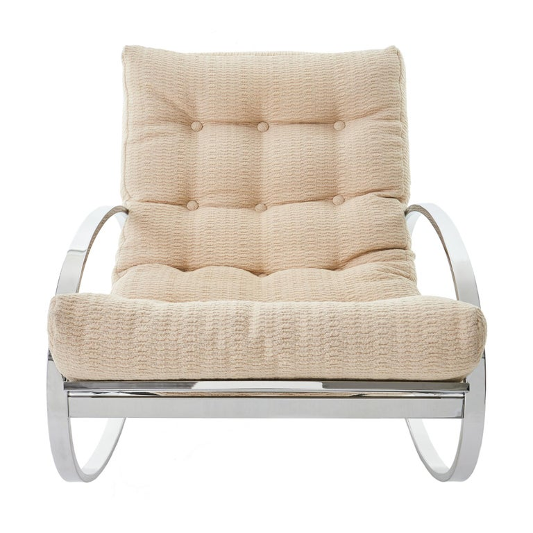 Gorgeous Mid-Century Modern chrome 'Ellipse' rocking chair designed by Renato Zevi for Selig. Sleek and glamorous design, featuring a polished chrome oval frame and original cream colored upholstered seat. 