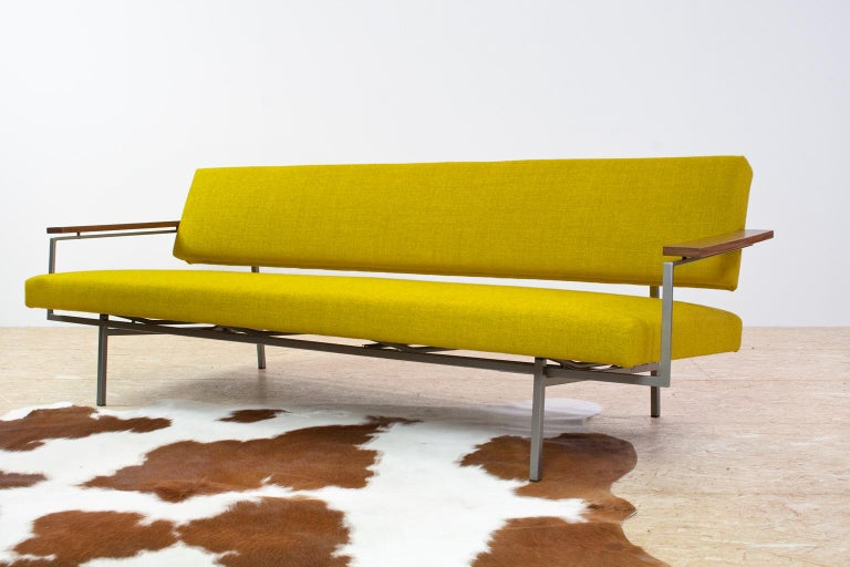 Original Rob Parry Lotus 75 on a grey lacquered metal frame, designed by Rob Parry for the Dutch editor Gelderland in the 1960s. The 3-seat sofa is new upholstered in a yellow (no.66) Ploegwool - De Ploeg, furniture fabric. The seat can be pulled