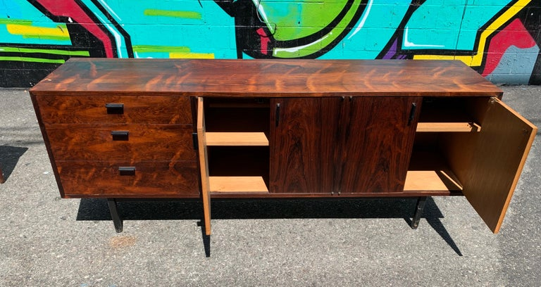 We are pleased to offer this stunning Mid-Century Modern credenza. Originally designed as a sideboard, it would also make a great media cabinet or serve well at the workplace. A fabulous piece that will make a statement in your dining room, living