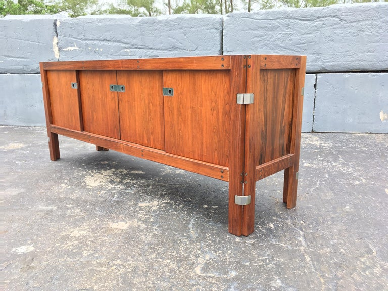 "Beautiful Rosewood Credenza with removable hutch. Partly solid and veneered. Hutch is removable and has two glass sliding doors. Bottom credenza has four sliding doors, 4 drawers and two shelves. Height of credenza without hutch is 29.50""."