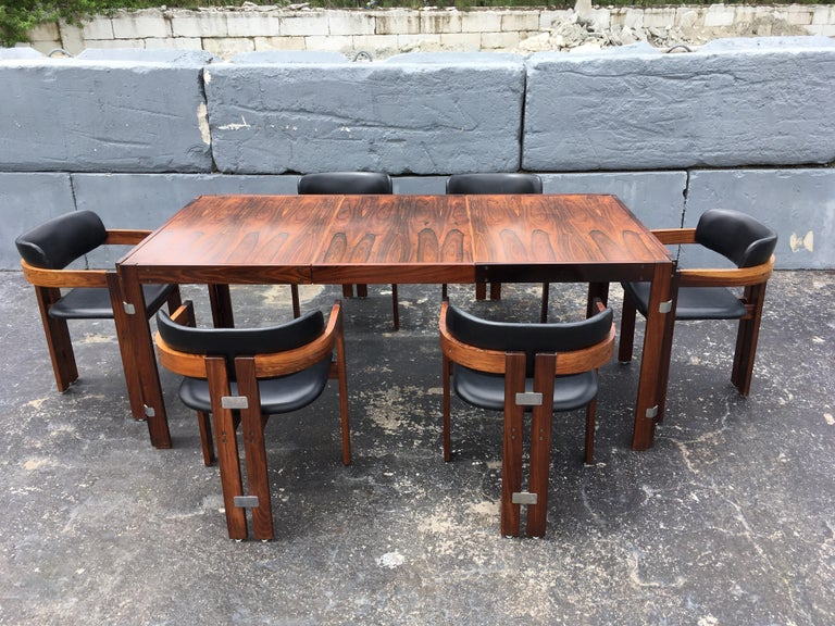 """Beautiful rosewood dining table, partly solid and veneered. Table has one leaf, without leaf table is 53.25"""" wide. Please see all the nice design details of the table."""