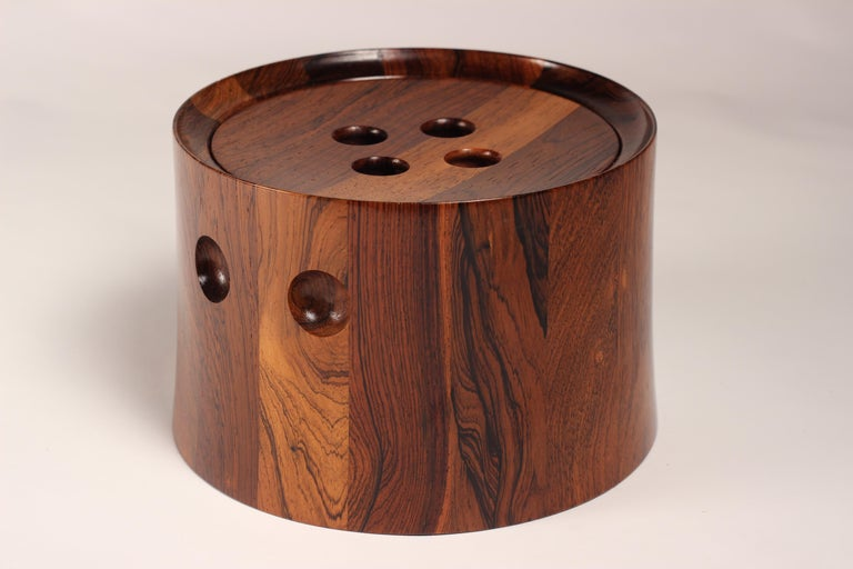 Scandinavian Modern rosewood ice bucket designed by Jens Quistgaard a master of sculptural paired back and beautifully simplistic forms. This rosewood ice bucket has had its wood sympathetically and selectively chosen in order to create an
