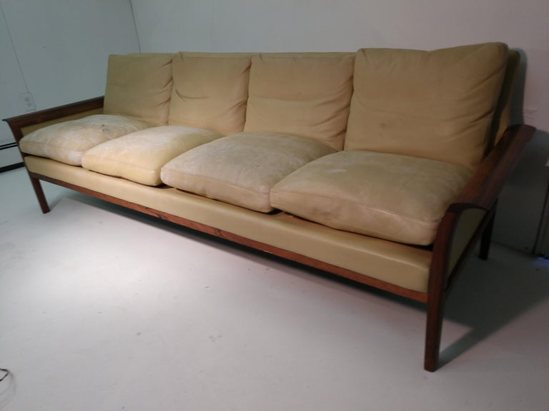 Fabulous leather with rosewood sofa by Knut Saeter for Vatne Møbler. Four seat sofa, very roomy and comfortable. Condition of sofa is great however cushions have significant wear. Rosewood is a beautiful grain and in great condition.