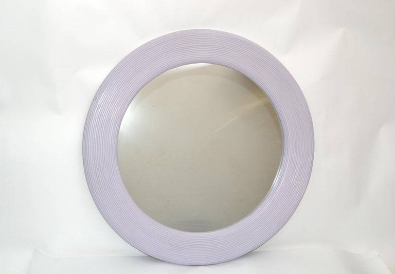 Mid-Century Modern round handmade in light purple finish pencil reed wall mirror. The mirror is woven with pencil reed and has wooden backing. Great for the sunroom.