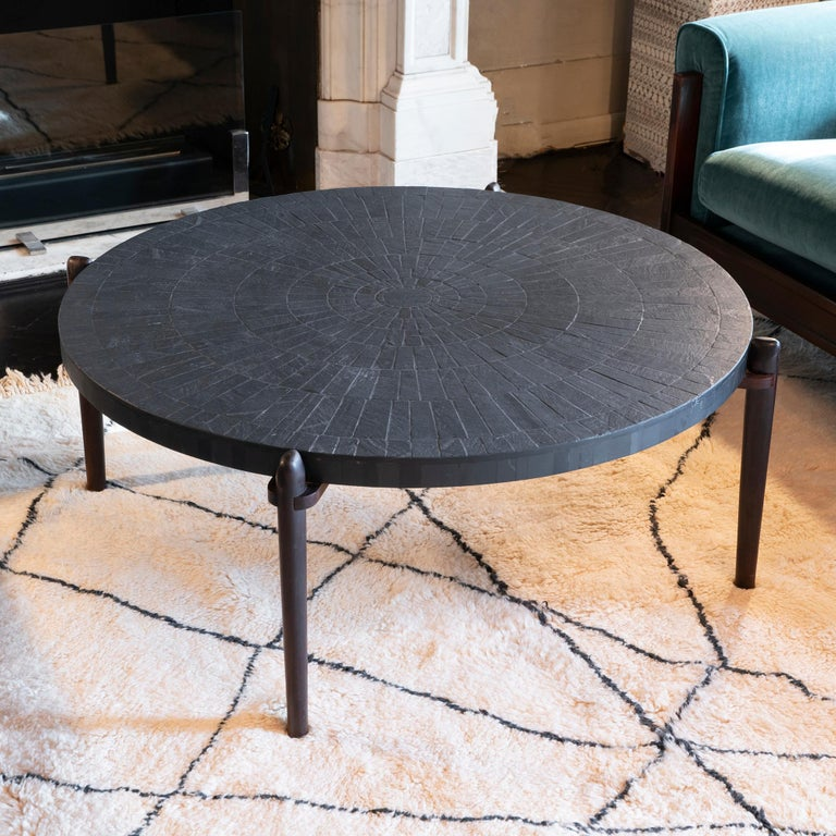Mid-Century Modern round coffee table with inlay slate top (diameter cm110) with palisander legs, perfect condition and vintage patina, some slight chipping on the top, Belgium, 1960s.