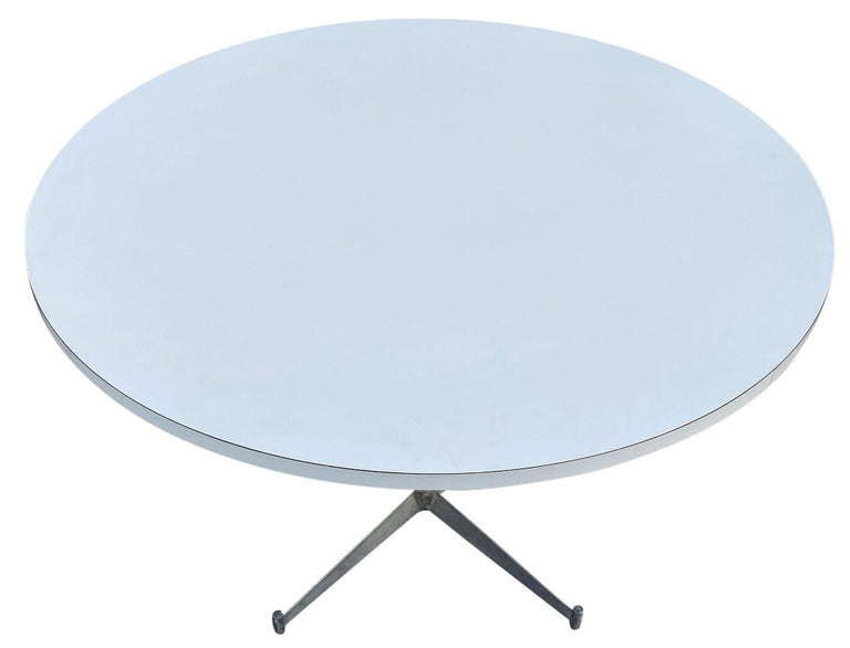 A Mid-Century Modern round white laminate dining table with aluminum base designed by Paul McCobb. The table is in great original vintage condition. Great design, rare table.