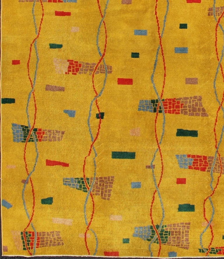 Mid-Century Modern Rug, Turkish Carpet in Bright Yellow, Red, Blue, Green & Pink. This beautiful Mid-Century rug rests on a saturated yellow background with brilliant accent colors.  Measures: 6'10 x 10'1