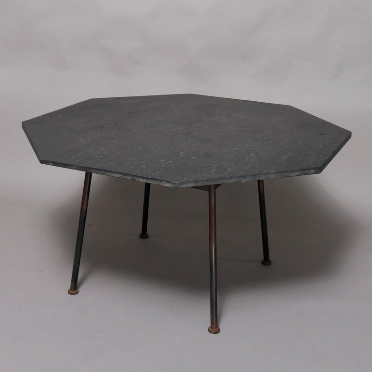 A Mid-Century Modern Russell Woodard dining set offers octagon slate top table on metal legs and six metal mesh chairs having vinyl cushions, circa 1960  ***DELIVERY NOTICE – Due to COVID-19 we are employing NO-CONTACT PRACTICES in the transfer of
