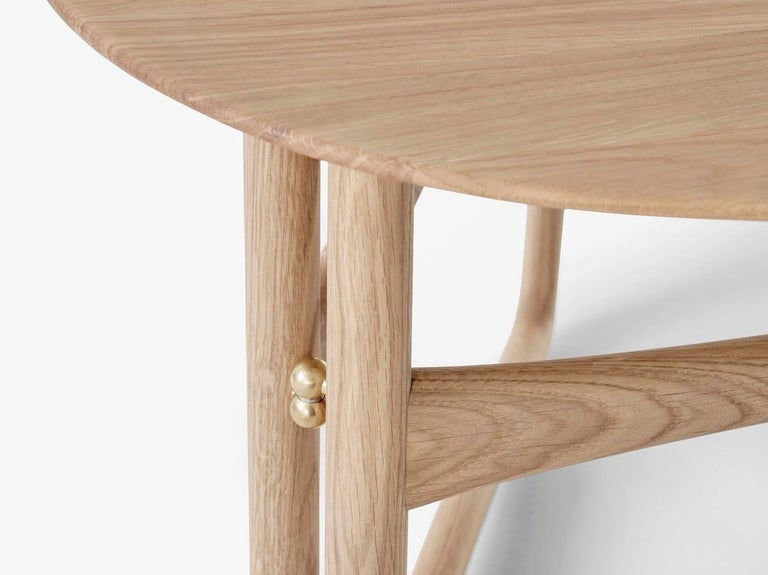 Drop Leaf folding side table HM5 by Hvidt and Mølgaard. New edition. Looking to create a versatile piece that would adapt to its surroundings, design duo Hvidt & Mølgaard devised this handsome lounge table in 1956. As part of the Drop Leaf series,
