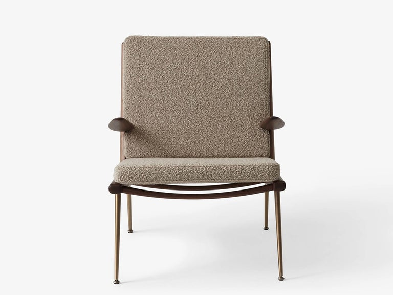 Boomerang lounge chair HM1 by Hvidt and Mølgaard. New edition. Debuted in 1956, the lounge chair by duo Hvidt & Mølgaard has a no-frills, streamlined form. From the hand-polished wooden frame, to its slender brass legs, the Boomerang endures as a
