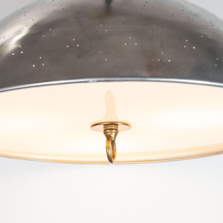 Mid-Century Modern Scandinavian Perforated Aluminum, Brass and Lucite Pendant In Excellent Condition For Sale In New York, NY