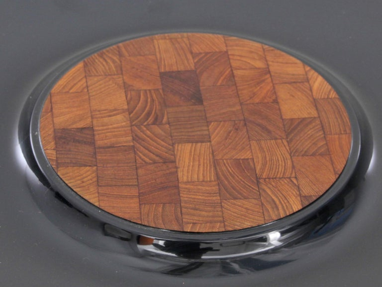 Scandinavian tray by Jens Quistgaard for Dansk International Designs. Black lacquer and teak wood marquetry. The lacquer is slightly scratched. One small crackling.