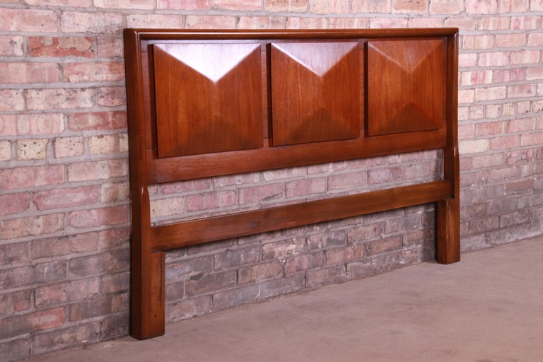 An exceptional Mid-Century Modern sculpted walnut diamond front headboard