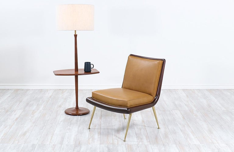 Mid-Century Modern sculpted walnut floor lamp with side table by Laurel.