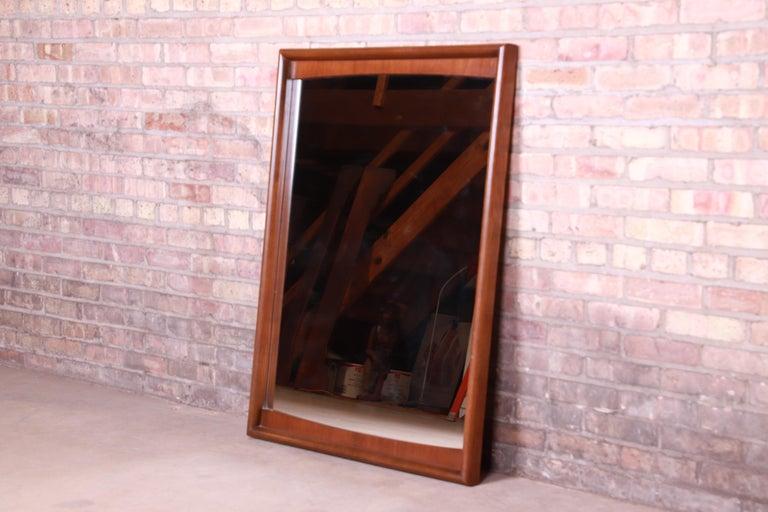 American Mid-Century Modern Sculpted Walnut Framed Mirror by United, 1960s