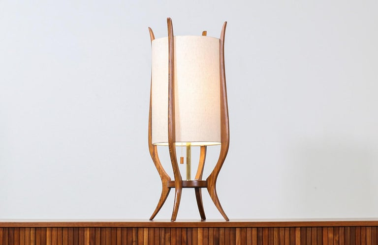 Mid-Century Modern sculpted walnut table lamp by Modeline.