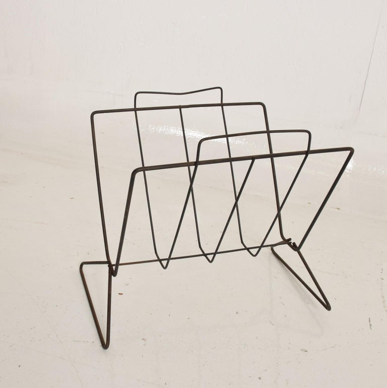 For your consideration, a Mid-Century Modern sculptural iron magazine rack. Beautiful clean modern lines. The USA circa the 1960s. Dimensions: TBD 12