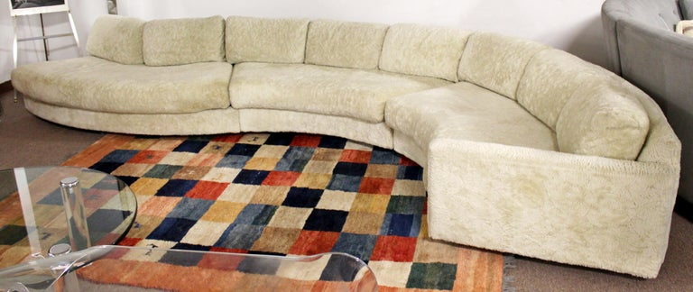 For your consideration is a mesmerizing, curved serpentine, three piece sofa sectional, by Adrian Pearsall, circa 1970s. In excellent vintage condition. The dimensions of each piece are 75