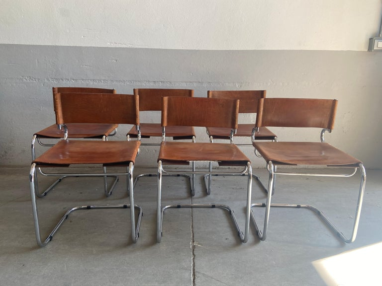 Mid-Century Modern Luigi Saccardo for Arrmet, set of six 'Terrj' dining chairs, leather, chromed metal, Italy, 1970s This set of six cantilever chairs consists of a tubular chromed steel frame with leather seat and back. The leather shows admirable