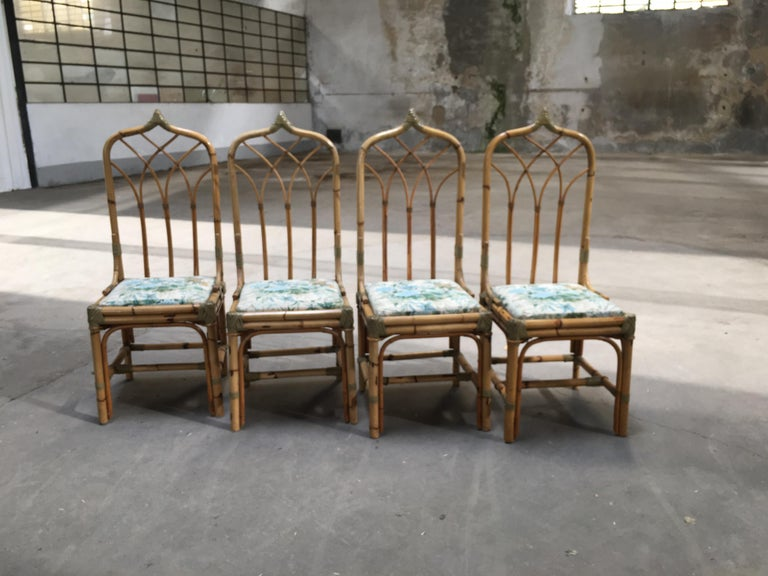 Mid-Century Modern set of four bamboo Italian chairs with floral cushions All the binding of the chairs are made with leather laces. If needed, the chairs could be sold together with their dining table as shown in the pictures.