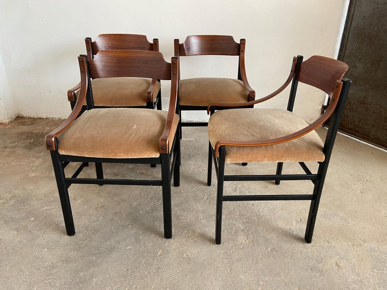 Mid-Century Modern Danish set of four dining room chairs with original upholstery.  The chairs are in really good vintage conditions.  The back of one piece shows traces of age and use (see photo).