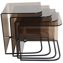 Mid-Century Modern Set of Four Nesting Tables Smoke Lucite and Iron
