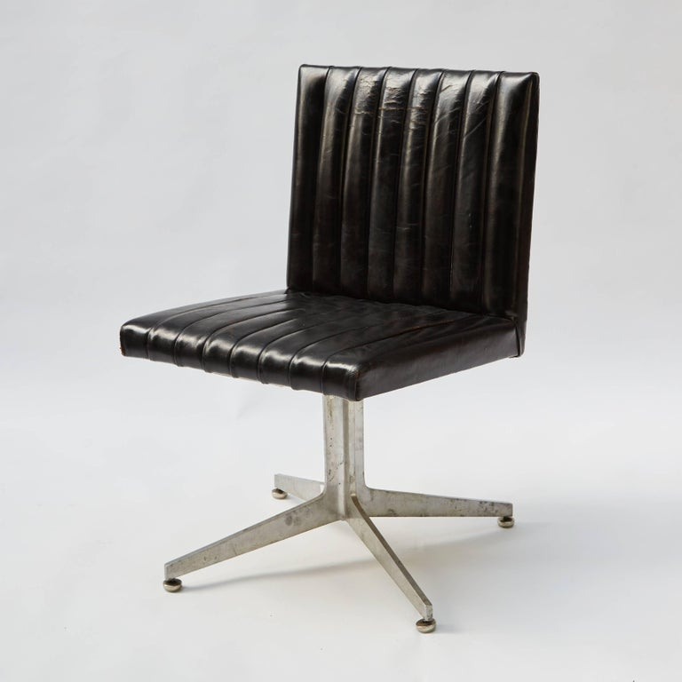 Mid-Century Modern set of four Eames black leather swivel chairs designed for Herman Miller. Chairs are upholstered in black leather with chrome bases.