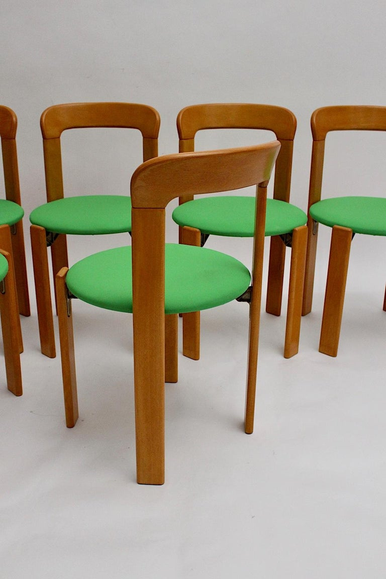 Mid-Century Modern Set of Seven Brown Wood Dining Room Chairs by Bruno Rey 1970s For Sale 4