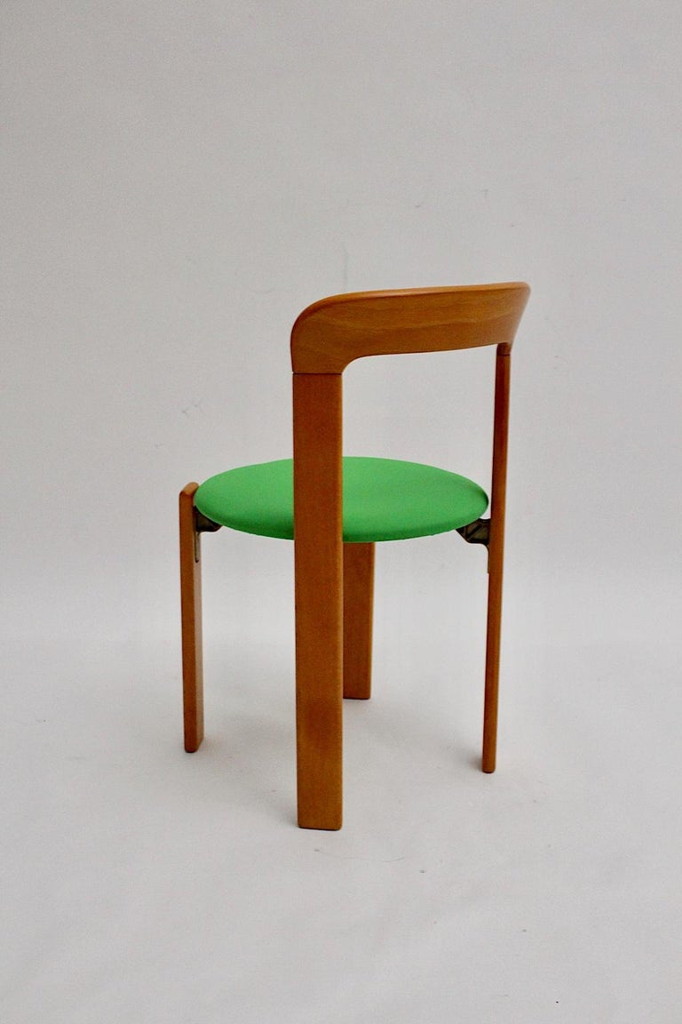 Mid-Century Modern Set of Seven Brown Wood Dining Room Chairs by Bruno Rey 1970s For Sale 7