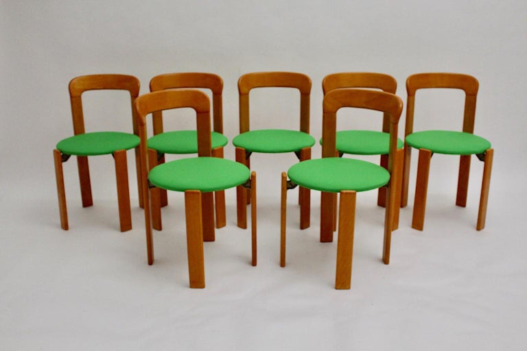 Swiss Mid-Century Modern Set of Seven Brown Wood Dining Room Chairs by Bruno Rey 1970s For Sale