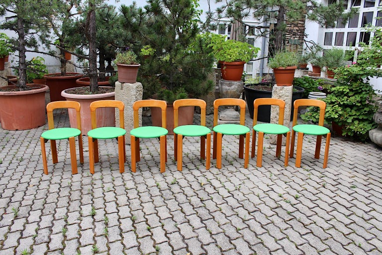 Mid-Century Modern Set of Seven Brown Wood Dining Room Chairs by Bruno Rey 1970s In Good Condition For Sale In Vienna, AT
