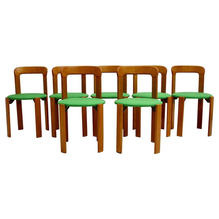 Mid-Century Modern Set of Seven Brown Wood Dining Room Chairs by Bruno Rey 1970s For Sale