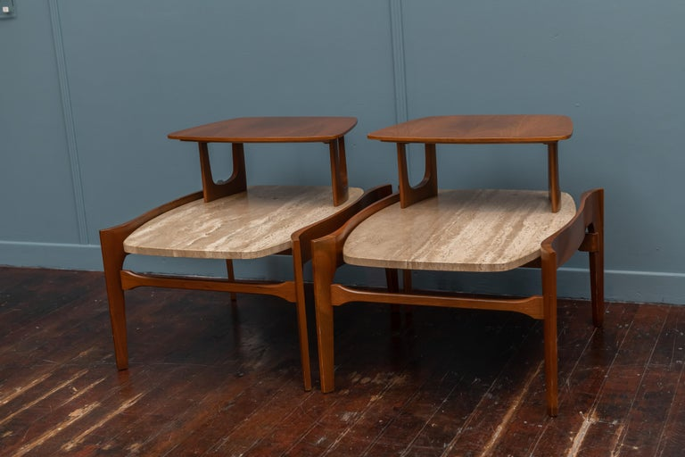 Mid-Century Modern travertine and wood tiered end tables designed by Bertha Schaefer. Lovely serpentine design in very good original condition.