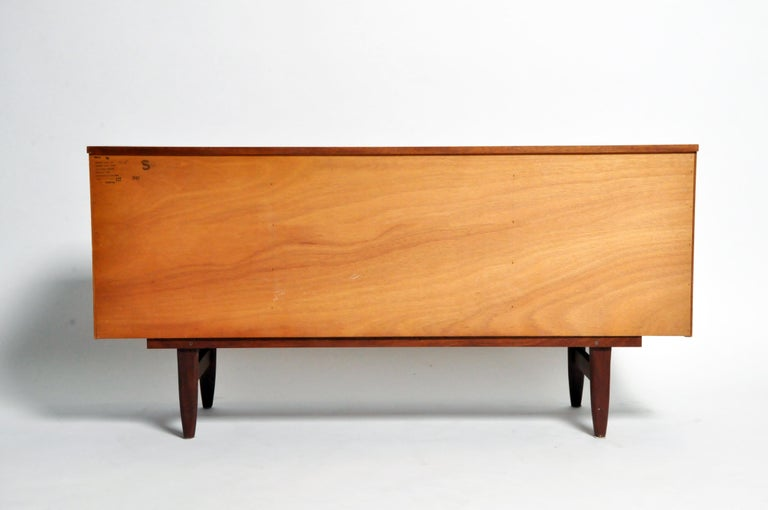This meticulously made sideboard is a superb example of British midcentury furniture design. Though less famous than Scandinavian Modern, midcentury design's British variant is very well-regarded for its iconoclasm and structural integrity. It also